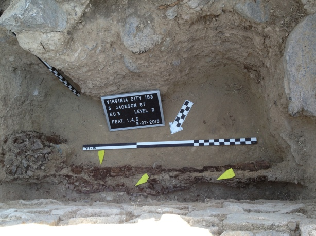 Gheri and John followed the foundation wall down about 4 feet below the surface. They uncovered the builders trench which ran next to the wall and the remains of a large wooden post.