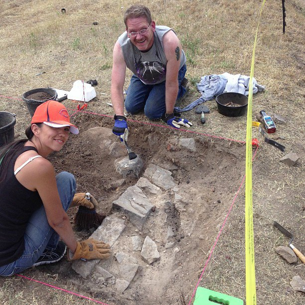 Students John and Jerry discover the remains of a foundation that may have provided support to one of the buildings.